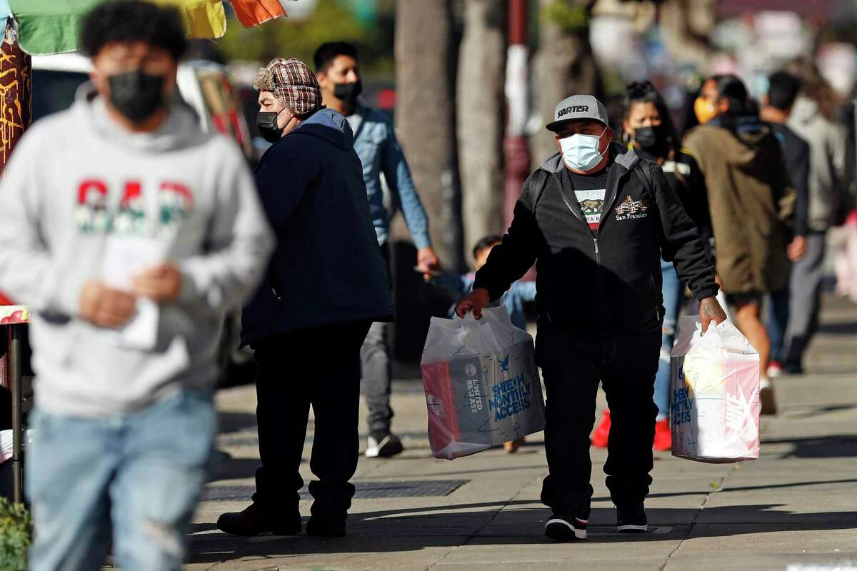 Pedestrians were face coverings on Mission Street in San Francisco, Calif., on Wednesday, February 17, 2021.