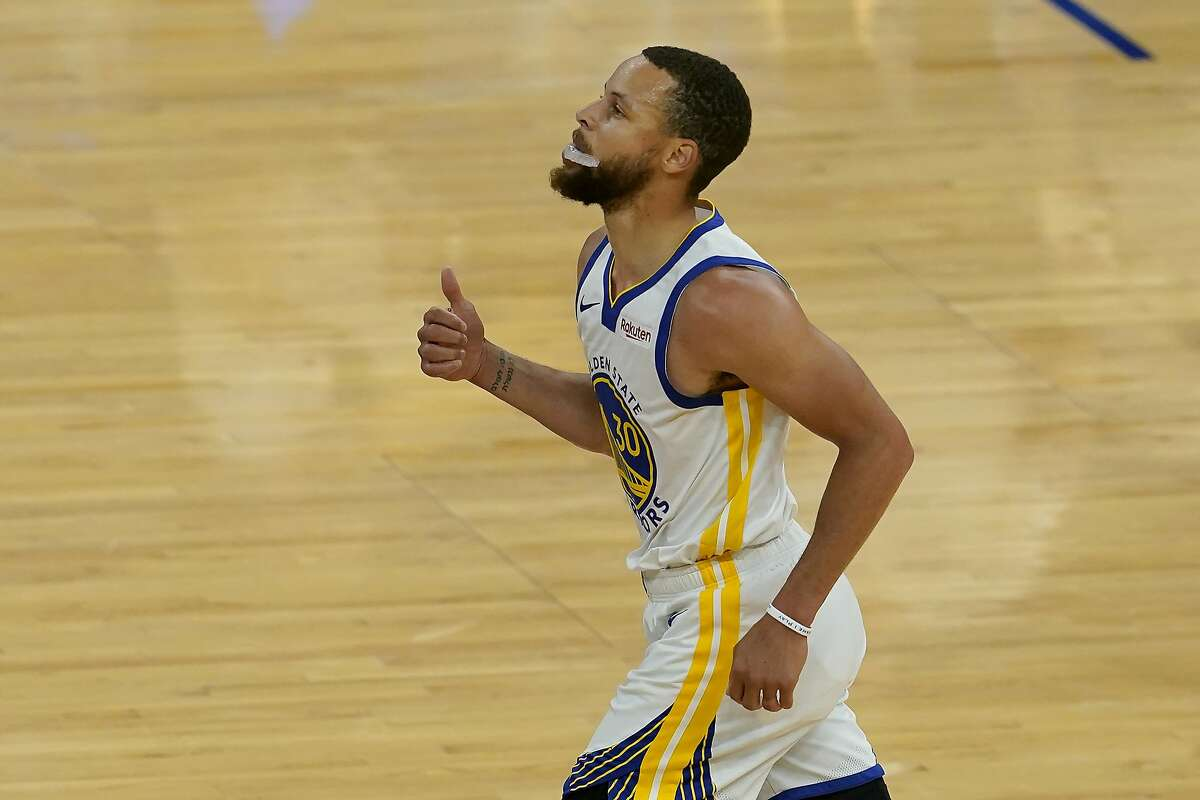 Golden State Warriors guard Stephen Curry runs up the court after scoring against the Memphis Grizzlies during the first half of an NBA basketball game in San Francisco, Sunday, May 16, 2021. (AP Photo/Jeff Chiu)
