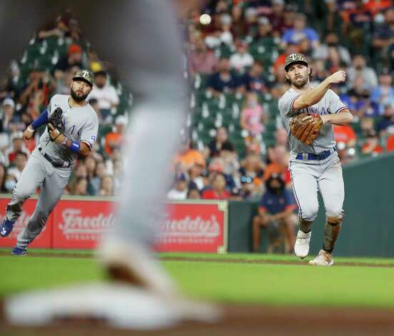 Texas Rangers third baseman Charlie Culberson (2) makes the throw to first base as Houston Astros Carlos Correa ground out during the third inning of an MLB baseball game at Minute Maid Park, Sunday, May 16, 2021, in Houston. Photo: Karen Warren, Staff Photographer / @2021 Houston Chronicle