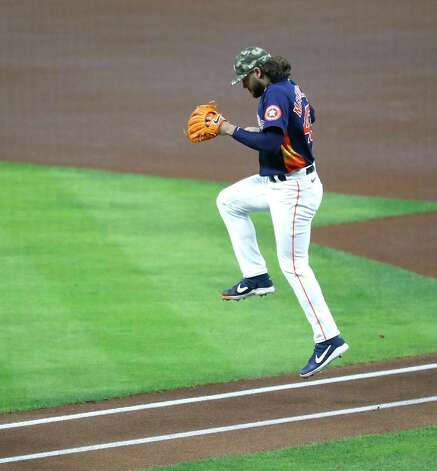 Houston Astros starting pitcher Lance McCullers Jr. (43) hops over the line on his way to take the mound before the start of the first inning of an MLB baseball game at Minute Maid Park, Sunday, May 16, 2021, in Houston. Photo: Karen Warren, Staff Photographer / @2021 Houston Chronicle
