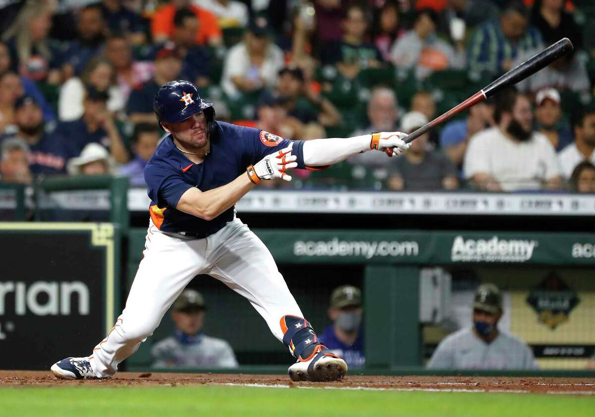 Houston Astros Chas McCormick (20) strikes out against Texas Rangers starting pitcher Kyle Gibson during the second inning of an MLB baseball game at Minute Maid Park, Sunday, May 16, 2021, in Houston.
