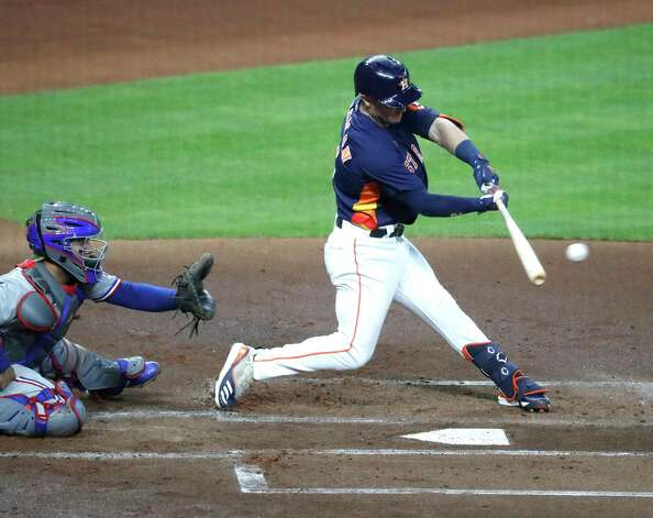 Houston Astros Alex Bregman (2) hits an RBI single during the first inning of an MLB baseball game at Minute Maid Park, Sunday, May 16, 2021, in Houston. Photo: Karen Warren, Staff Photographer / @2021 Houston Chronicle
