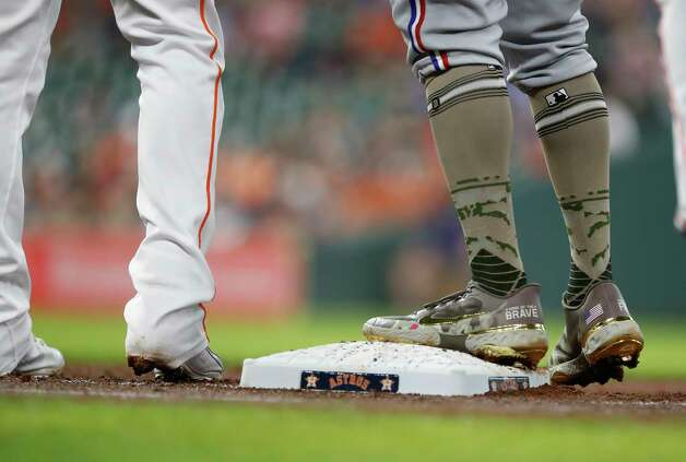 Texas Rangers designated hitter Khris Davis' shoes on first base during the second inning of an MLB baseball game at Minute Maid Park, Sunday, May 16, 2021, in Houston. Photo: Karen Warren, Staff Photographer / @2021 Houston Chronicle