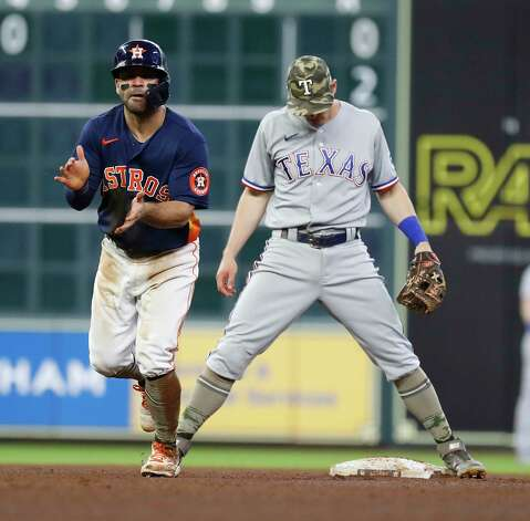 Texas Rangers second baseman Nick Solak (15) reacts after he tried to make the throw to first after tagging Houston Astros Jose Altuve (27) as Carlos Correa ground into a force out during the fifth inning of an MLB baseball game at Minute Maid Park, Sunday, May 16, 2021, in Houston. Photo: Karen Warren, Staff Photographer / @2021 Houston Chronicle