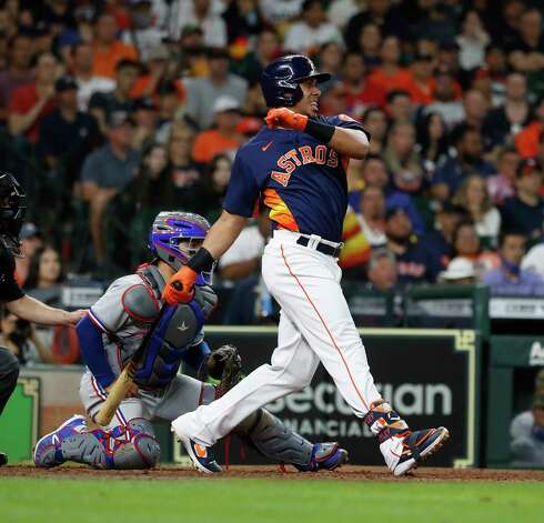 Houston Astros Michael Brantley (23) hits a line drive to Texas Rangers starting pitcher Kyle Gibson to end the fifth inning with the bases loaded during an MLB baseball game at Minute Maid Park, Sunday, May 16, 2021, in Houston. Photo: Karen Warren, Staff Photographer / @2021 Houston Chronicle