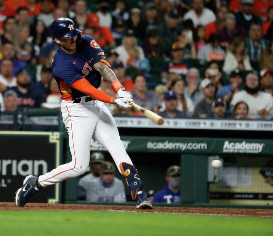 Houston Astros Carlos Correa (1)  hits into a force out during the fifth inning of an MLB baseball game at Minute Maid Park, Sunday, May 16, 2021, in Houston. Photo: Karen Warren, Staff Photographer / @2021 Houston Chronicle