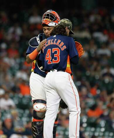 Houston Astros starting pitcher Lance McCullers Jr. (43) chats with catcher Martin Maldonado (15) after he walked Texas Rangers Khris Davis during the fourth inning of an MLB baseball game at Minute Maid Park, Sunday, May 16, 2021, in Houston. Photo: Karen Warren, Staff Photographer / @2021 Houston Chronicle