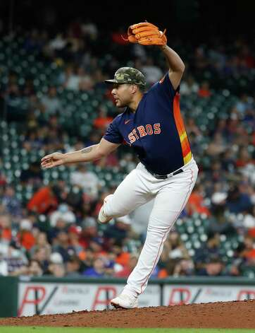 Houston Astros relief pitcher Andre Scrubb (70) pitches during the seventh inning of an MLB baseball game at Minute Maid Park, Sunday, May 16, 2021, in Houston. Photo: Karen Warren, Staff Photographer / @2021 Houston Chronicle