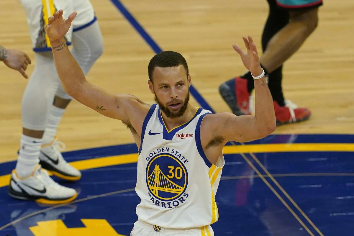 Golden State Warriors guard Stephen Curry reacts after shooting a 3-point basket against the Memphis Grizzlies during the second half of an NBA basketball game in San Francisco, Sunday, May 16, 2021.