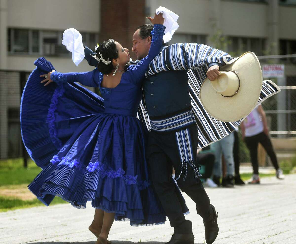 Peruvian dancers Miriam Reyes and Luis Trejo, both of Stamford, dance the Marinara as one of the many multicultural performances at Stamford Day at Mill River Park in Stamford, Conn. on Sunday, May 16, 2021.