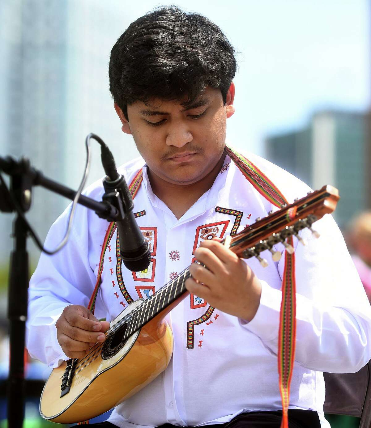 Stamford High senior Anthony De Paz performs traditional South American songs on the charrango as one of the many multicultural performances at Stamford Day at Mill River Park in Stamford, Conn. on Sunday, May 16, 2021.