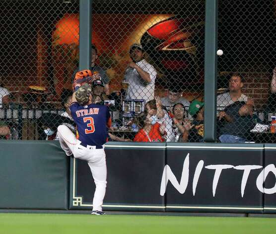 Houston Astros center fielder Myles Straw (3) tries to get a glove on Texas Rangers David Dahl's two-run home run during the seventh inning of an MLB baseball game at Minute Maid Park, Sunday, May 16, 2021, in Houston. Photo: Karen Warren, Staff Photographer / @2021 Houston Chronicle