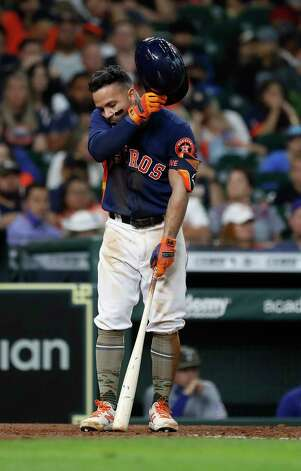 Houston Astros Jose Altuve (27) wipes his face at bat against Texas Rangers Joely Rodriguez during the eighth inning of an MLB baseball game at Minute Maid Park, Sunday, May 16, 2021, in Houston. Photo: Karen Warren, Staff Photographer / @2021 Houston Chronicle