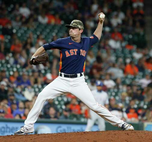 Houston Astros relief pitcher Brooks Raley (58) pitches during the eighth inning of an MLB baseball game at Minute Maid Park, Sunday, May 16, 2021, in Houston. Photo: Karen Warren, Staff Photographer / @2021 Houston Chronicle