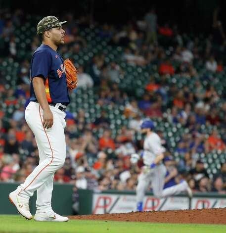 Houston Astros relief pitcher Andre Scrubb (70) reacts after giving up a tw-run home run to Texas Rangers David Dahl during the seventh inning of an MLB baseball game at Minute Maid Park, Sunday, May 16, 2021, in Houston. Photo: Karen Warren, Staff Photographer / @2021 Houston Chronicle