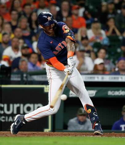 Houston Astros Carlos Correa (1) singles during the eighth inning of an MLB baseball game at Minute Maid Park, Sunday, May 16, 2021, in Houston. Photo: Karen Warren, Staff Photographer / @2021 Houston Chronicle