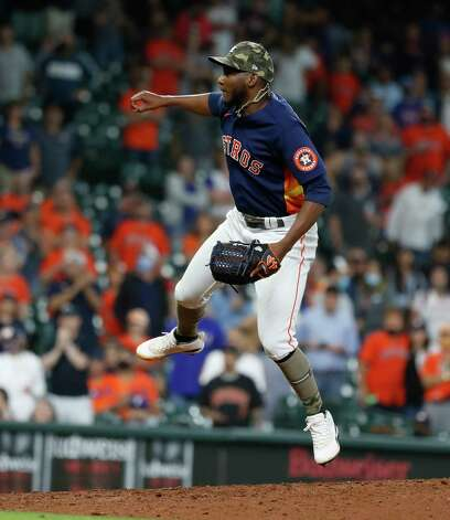 Houston Astros Enoli Parades pitches during the ninth inning of an MLB baseball game at Minute Maid Park, Sunday, May 16, 2021, in Houston. Astros won the game 6-2 against the Texas Rangers. Photo: Karen Warren, Staff Photographer / @2021 Houston Chronicle