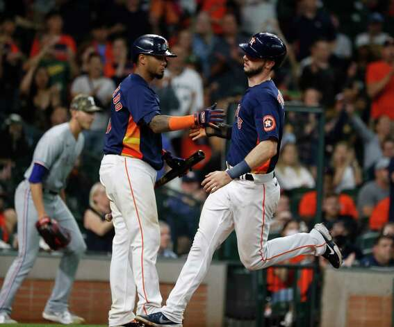 Houston Astros Kyle Tucker (30) celebrates with Martin Maldonado (15) after scoring a run on Myles Straw's RBI single during the ninth inning of an MLB baseball game at Minute Maid Park, Sunday, May 16, 2021, in Houston. Astros won the game 6-2 against the Texas Rangers. Photo: Karen Warren, Staff Photographer / @2021 Houston Chronicle