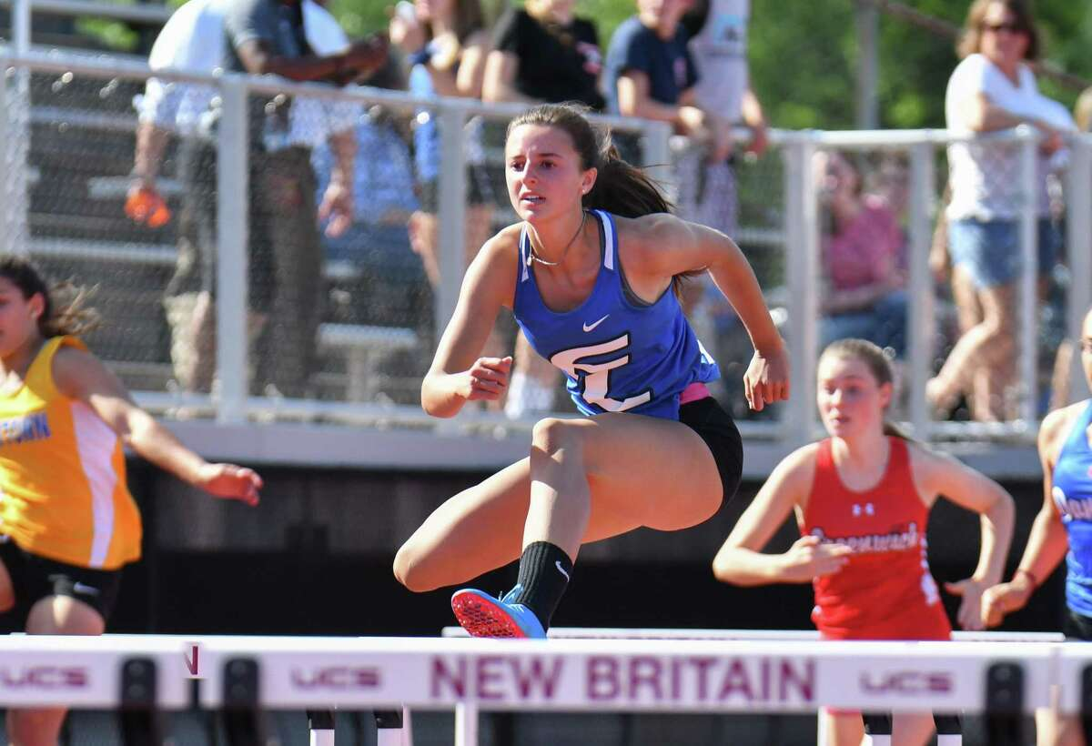 Tess Stapleton of Fairfield Ludlowe competes in the 100 meter hurdles during the Class LL State Track and Field Championship on Wednesday May 30, 2018, at Willow Brook Park in New Britain, Connecticut.