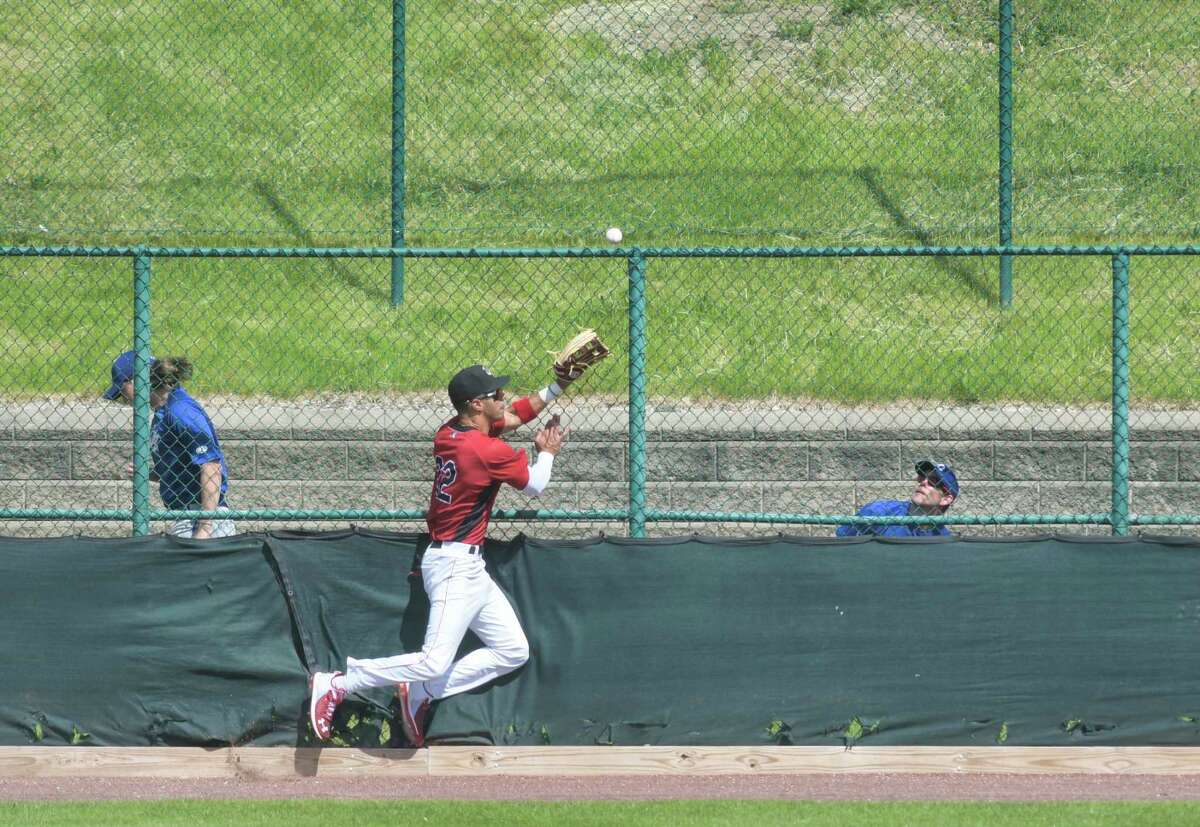 Avery Tuck, outfielder for the Tri-City ValleyCats, hits the fence as he chased a hit that went over the fence for a home run during their exhibition game on Sunday, May 16, 2021, in Troy, N.Y. (Paul Buckowski/Times Union)