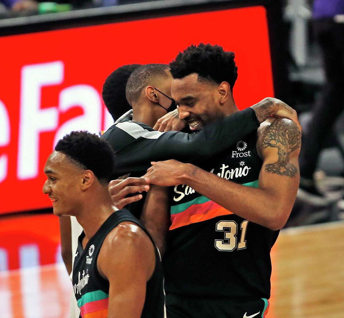 SAN ANTONIO, TX - MAY 16: Keita Bates-Diop #31 of the San Antonio Spurs is hugged by Dejounte Murray #5 after the basket put the Spurs ahead of the Phoenix Suns with second remaining in the second half at AT&T Center on May 16, 2021 in San Antonio, Texas. NOTE TO USER: User expressly acknowledges and agrees that , by downloading and or using this photograph, User is consenting to the terms and conditions of the Getty Images License Agreement. (Photo by Ronald Cortes/Getty Images)
