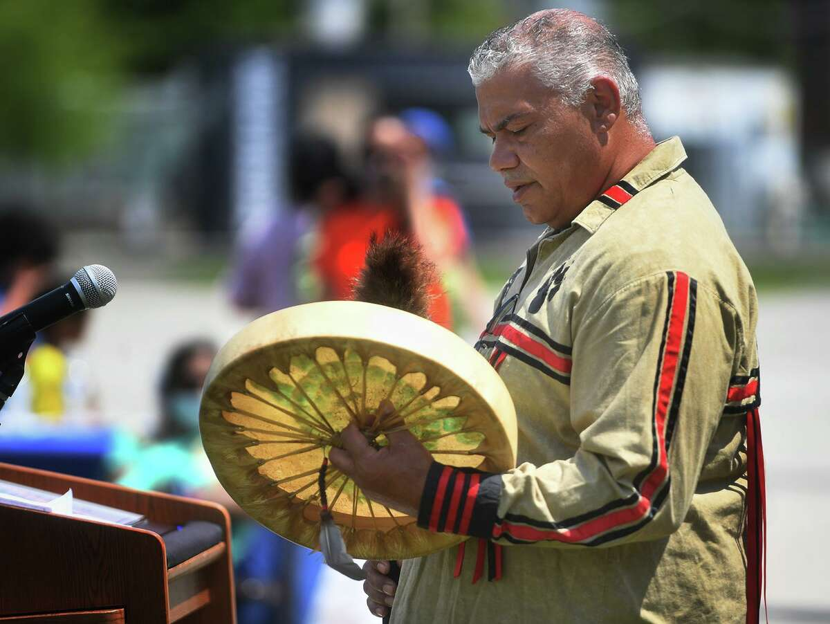 Vincent Mann, chief of the Turtle Clan of the Ramapough Lunaape Nation, the resident tribe in the Stamford area during European settlement, beats a drum while singing in his native tongue at Stamford Day at Mill River Park in Stamford on Sunday.
