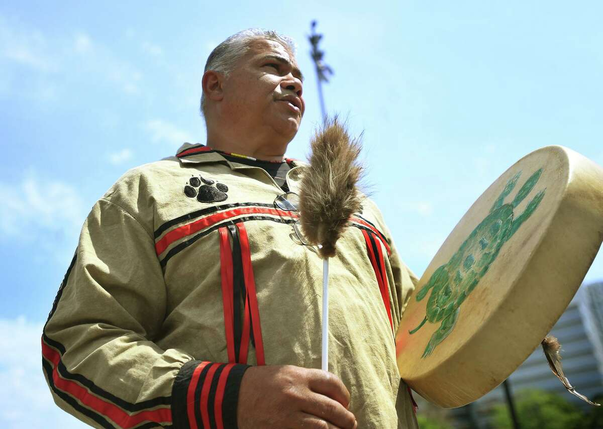 Vincent Mann, chief of the Turtle Clan of the Ramapough Lunaape Nation, the resident tribe in the Stamford area during European settlement, beats a drum while singing in his native tongue at Stamford Day at Mill River Park in Stamford, Conn. on Sunday, May 16, 2021.