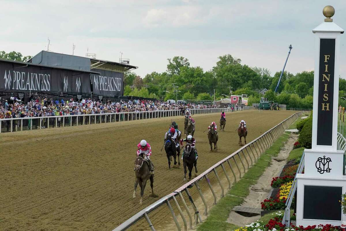 Flavien Prat atop Rombauer, front, wins the 146th Preakness Stakes horse race at Pimlico Race Course, Saturday, May 15, 2021, in Baltimore. (AP Photo/Julio Cortez)