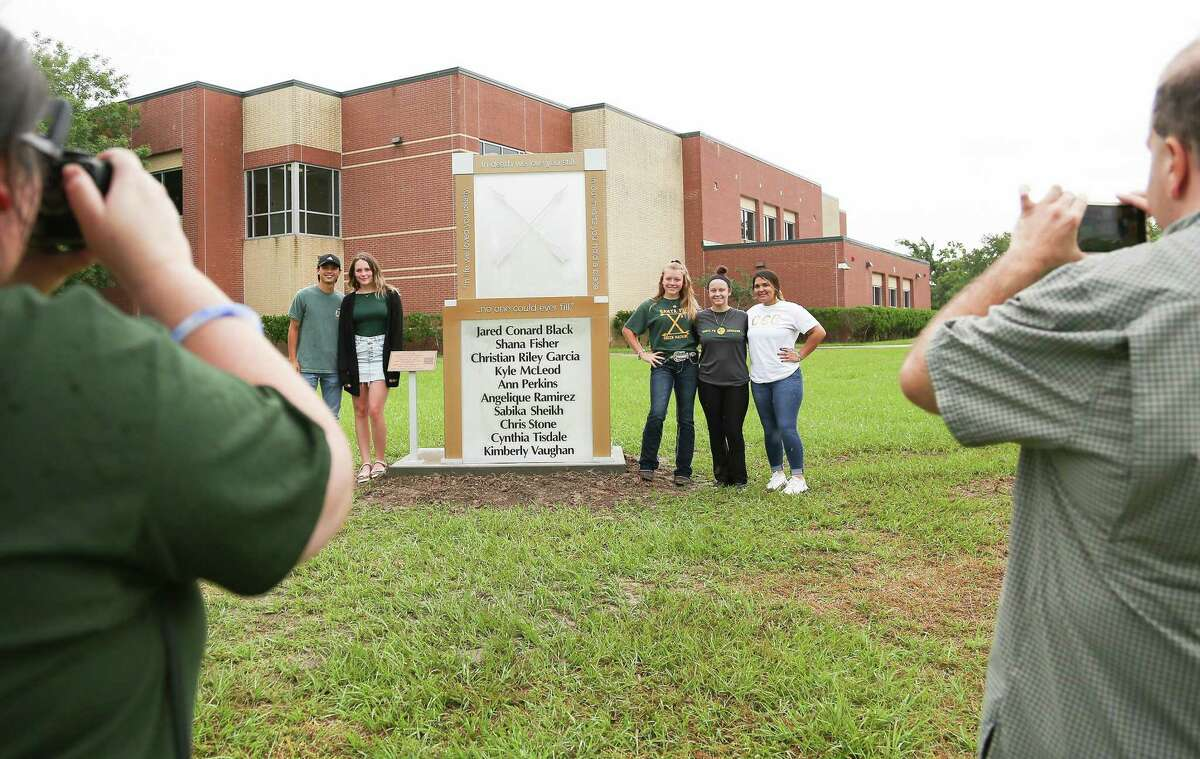 Student designers for the memorial include Corrigan Garcia (2018), Maegan Huddleston (2019), Chailyn Gillespie (2021), Morgan Wilson (2021) and Reagan Gaona (2020) stand by the memorial in front of Santa Fe High School on Sunday, May 16, 2021. May 18 marks the third year anniversary of the deadly shooting at the school.