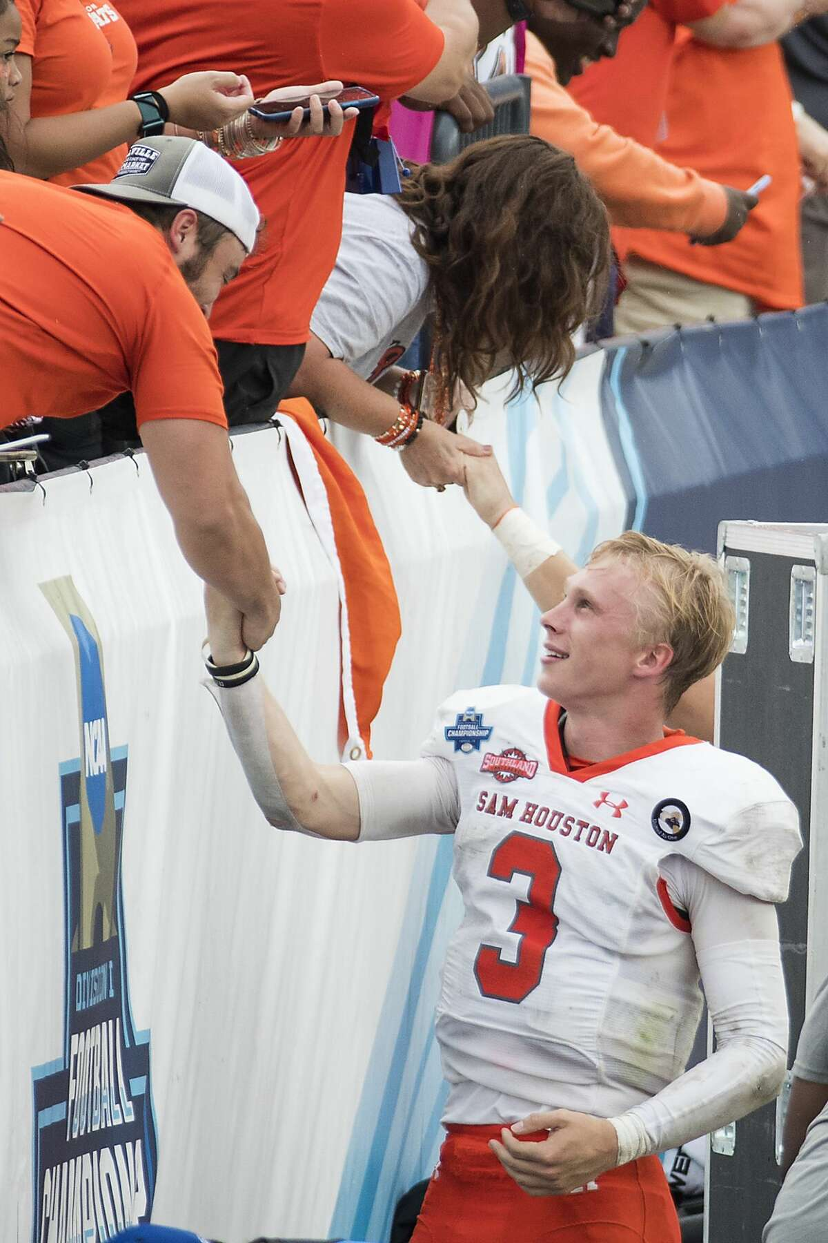 Sam Houston State quarterback Eric Schmid (3) shakes hands with fans as he celebrates the Bearkats 23-21 win over South Dakota State in the NCAA FCS national football championship game on Sunday, May 16, 2021, in Frisco.