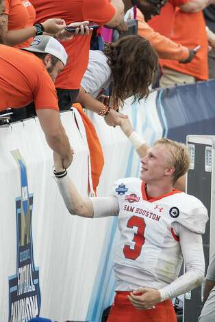 Sam Houston State quarterback Eric Schmid (3) shakes hands with fans as he celebrates the Bearkats 23-21 win over South Dakota State in the NCAA FCS national football championship game on Sunday, May 16, 2021, in Frisco. Photo: Brett Coomer/Staff Photographer / © 2021 Houston Chronicle