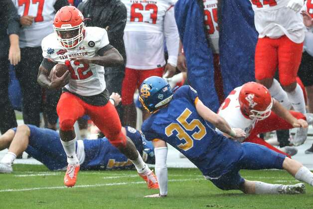 Sam Houston State wide receiver Jequez Ezzard (12) cuts back across the field past South Dakota State safety Chase Norblade (35) on his way to a 35-yard touchdown reception during the second quarter of the NCAA FCS national football championship game on Sunday, May 16, 2021, in Frisco. Photo: Brett Coomer/Staff Photographer / © 2021 Houston Chronicle