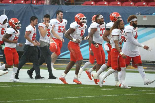 Sam Houston State players run off the field for a lightning delay during the second quarter of the NCAA FCS national football championship game on Sunday, May 16, 2021, in Frisco. Photo: Brett Coomer/Staff Photographer / © 2021 Houston Chronicle