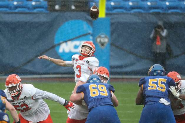 Sam Houston State quarterback Eric Schmid (3) can't come down with a high snap that South Dakota State recovered for a turnover during the first quarter of the NCAA FCS national football championship game on Sunday, May 16, 2021, in Frisco. Photo: Brett Coomer/Staff Photographer / © 2021 Houston Chronicle
