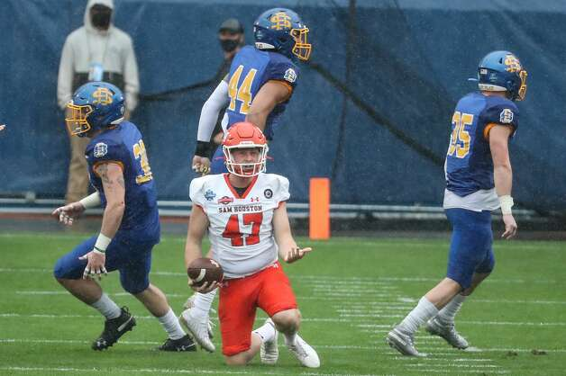 Sam Houston State punter Matt McRobert (47) reacts after he was forced to cover loose ball after dropping the snap during the first quarter of the NCAA FCS national football championship game on Sunday, May 16, 2021, in Frisco. Photo: Brett Coomer/Staff Photographer / © 2021 Houston Chronicle