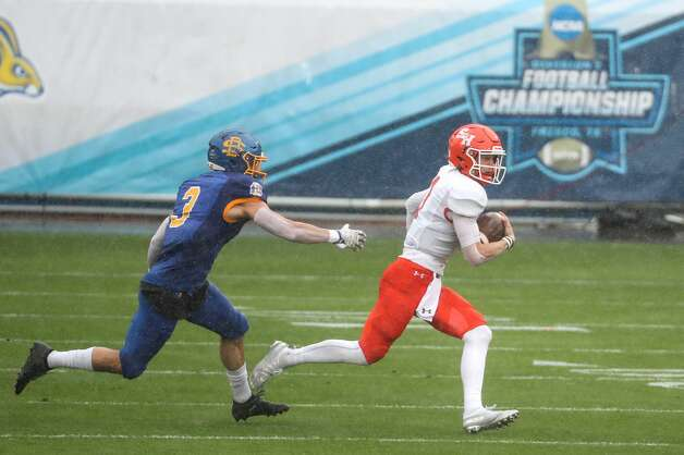 Sam Houston State quarterback Eric Schmid (3) breaks out of the pocket avoiding the rush by South Dakota State safety Joshua Manchigiah (3) during the firstmquarter of the NCAA FCS national football championship game on Sunday, May 16, 2021, in Frisco. Photo: Brett Coomer/Staff Photographer / © 2021 Houston Chronicle