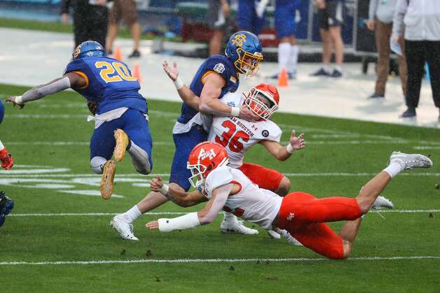 South Dakota State running back Pierre Strong Jr. (20) is tripped up by Sam Houston State defensive back Zyon McCollum (22) during the first quarter of the NCAA FCS national football championship game on Sunday, May 16, 2021, in Frisco. Photo: Brett Coomer/Staff Photographer / © 2021 Houston Chronicle