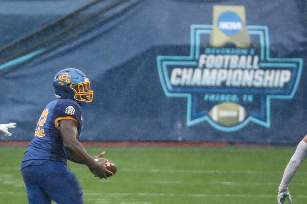 South Dakota State defensive end Kevin Brenner (92) runs off the field after recovering a fumble by Sam Houston State quarterback Eric Schmid during the first quarter of the NCAA FCS national football championship game on Sunday, May 16, 2021, in Frisco. Photo: Brett Coomer/Staff Photographer / © 2021 Houston Chronicle
