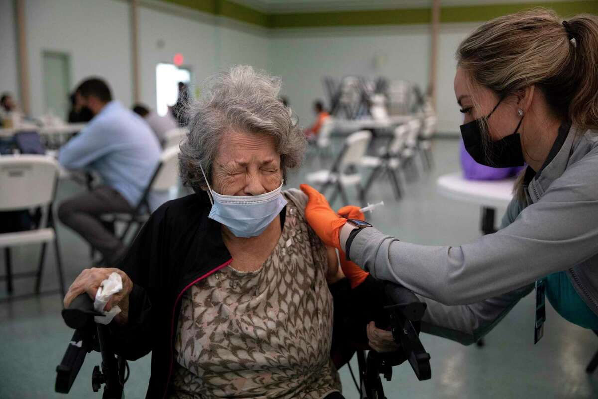 Lydia Guerrero receives her coronavirus vaccine at a mobile clinic organized by the city of San Antonio at St. Henry's Catholic Church south of downtown.
