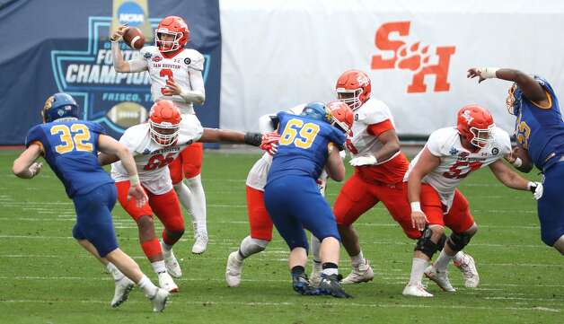 Sam Houston State quarterback Eric Schmid (3) takes a shotgun snap against South Dakota State during the second half of the NCAA FCS national football championship game on Sunday, May 16, 2021, in Frisco. Sam Houston took the title with a 23-21 win. Photo: Brett Coomer/Staff Photographer / © 2021 Houston Chronicle