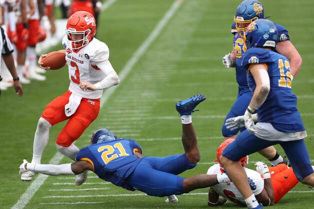 Sam Houston State quarterback Eric Schmid (3) is chased out of bounds by South Dakota State cornerback Don Gardner (21) during the second half of the NCAA FCS national football championship game on Sunday, May 16, 2021, in Frisco. Sam Houston took the title with a 23-21 win. Photo: Brett Coomer/Staff Photographer / © 2021 Houston Chronicle