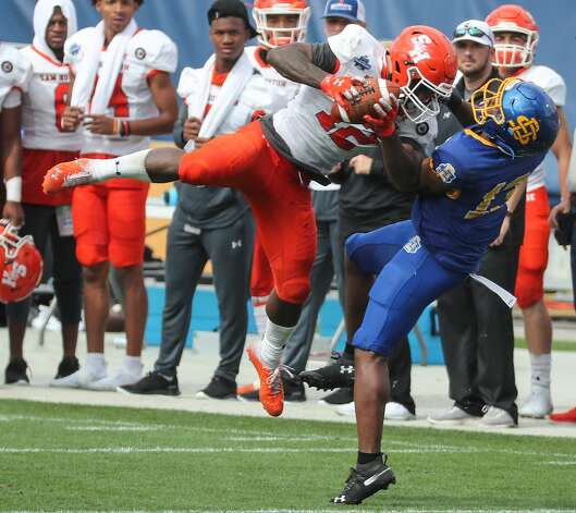 Sam Houston State wide receiver Jequez Ezzard (12) leaps over South Dakota State cornerback DyShawn Gales (13) to haul in a reception for a first down during the second half of the NCAA FCS national football championship game on Sunday, May 16, 2021, in Frisco. Sam Houston took the title with a 23-21 win. Photo: Brett Coomer/Staff Photographer / © 2021 Houston Chronicle