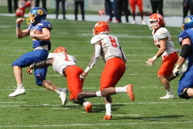 South Dakota State running back Isaiah Davis (22) breaks away from Sam Houston State linebacker Trevor Williams (1) on his way to an 85-yard touchdown run during the second half of the NCAA FCS national football championship game on Sunday, May 16, 2021, in Frisco. Sam Houston took the title with a 23-21 win. Photo: Brett Coomer/Staff Photographer / © 2021 Houston Chronicle