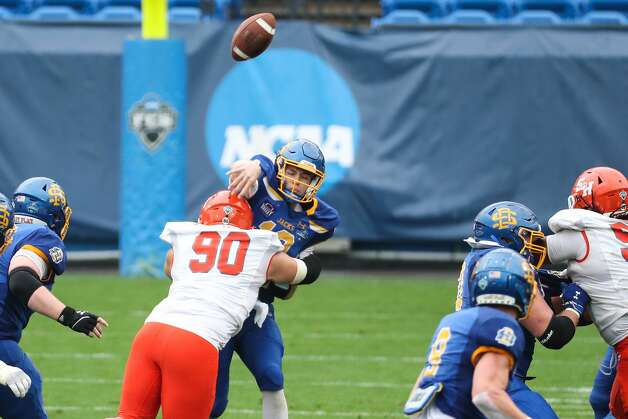 Sam Houston State defensive lineman Trace Mascorro (90) knocks a pass by South Dakota State quarterback Keaton Heide (13) off course during the second half of the NCAA FCS national football championship game on Sunday, May 16, 2021, in Frisco. Sam Houston took the title with a 23-21 win. Photo: Brett Coomer/Staff Photographer / © 2021 Houston Chronicle