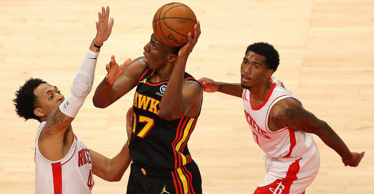 Onyeka Okongwu #17 of the Atlanta Hawks attacks the Cameron Reynolds #42 and Armoni Brooks #7 of the Houston Rockets during the first half at State Farm Arena on May 16, 2021 in Atlanta, Georgia. (Photo by Kevin C. Cox/Getty Images)