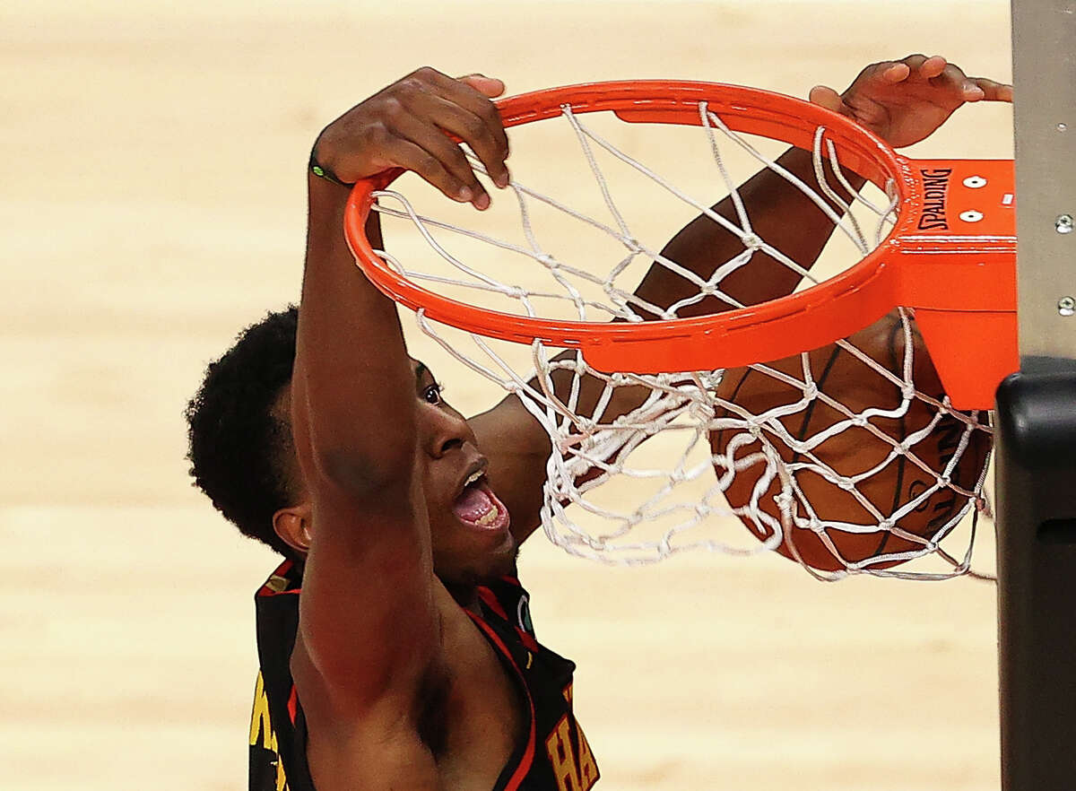 ATLANTA, GEORGIA - MAY 16: Onyeka Okongwu #17 of the Atlanta Hawks dunks against the Houston Rockets during the second half at State Farm Arena on May 16, 2021 in Atlanta, Georgia. NOTE TO USER: User expressly acknowledges and agrees that, by downloading and or using this photograph, User is consenting to the terms and conditions of the Getty Images License Agreement. (Photo by Kevin C. Cox/Getty Images)