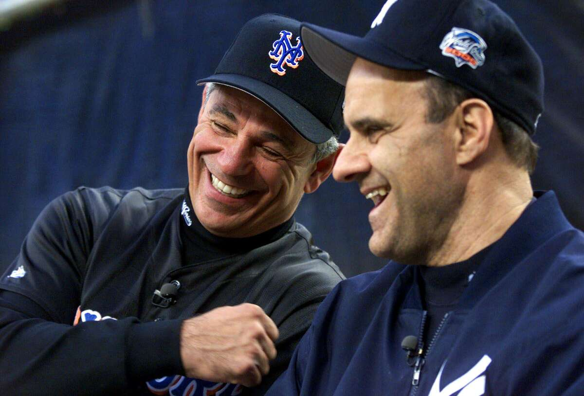 New York Mets manager Bobby Valentine, left, and New York Yankees manager Joe Torre give an interview prior to the start of the World Series between the Mets and the Yankees on Oct. 21, 2000 in New York.