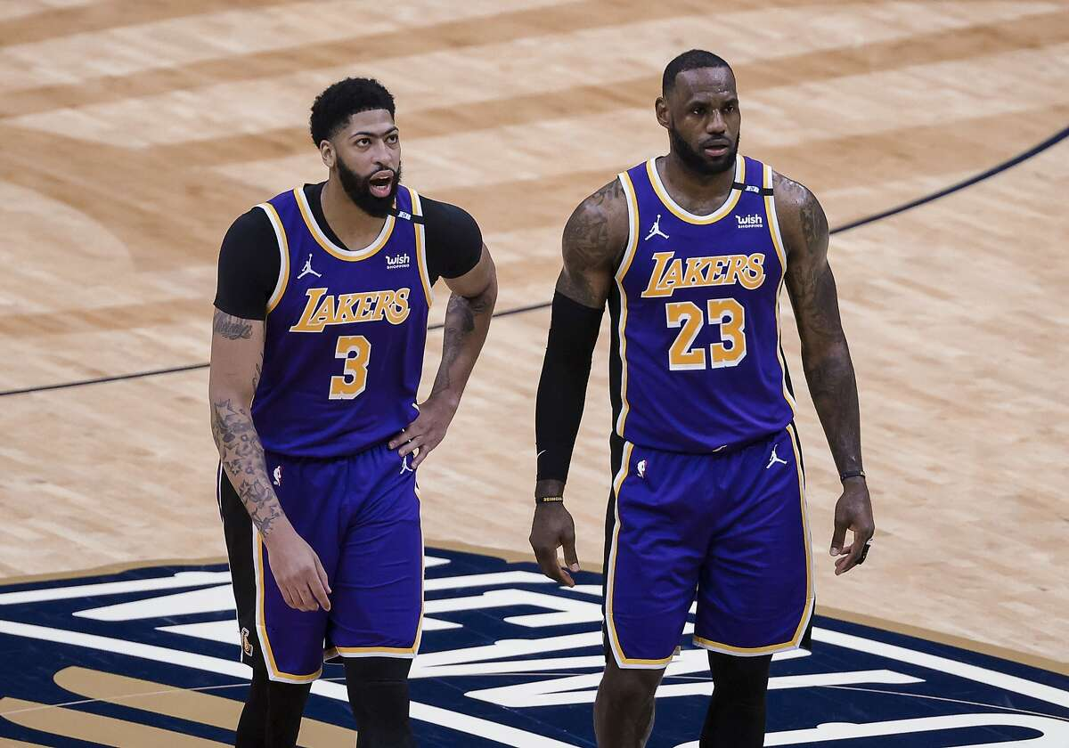 Anthony Davis, left, LeBron James and the Lakers host the Warriors in a play-in game at 7 p.m. Wednesday (ESPN/95.7).
