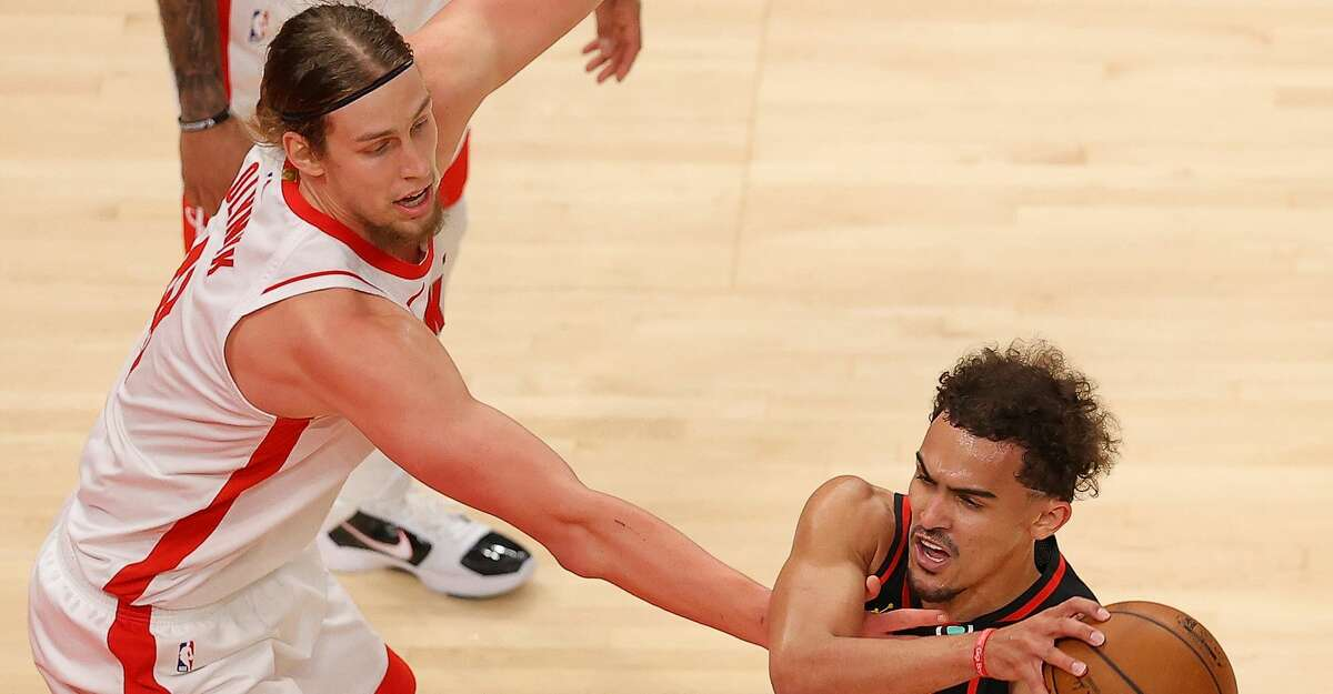 Kelly Olynyk #41 of the Houston Rockets defends against Trae Young #11 of the Atlanta Hawks during the first half at State Farm Arena on May 16, 2021 in Atlanta, Georgia. (Photo by Kevin C. Cox/Getty Images)