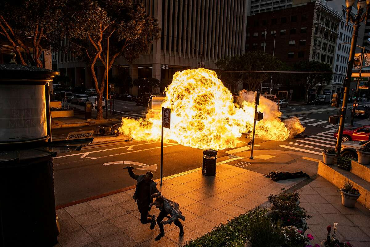 """A controlled explosion lights up a San Francisco street during the filming of the upcoming """"Nash Bridges"""" movie."""
